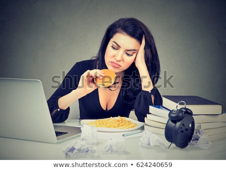 Woman eating her laptop in frustration Stock photo © photography33