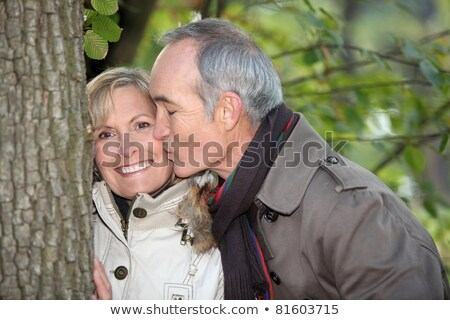 Older couple embracing on a winter's stroll Stock photo © photography33