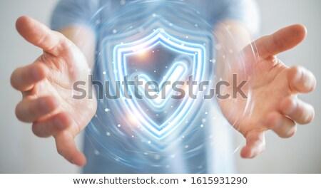 Businessman Touching A Holographic Screen Stock photo © sdecoret