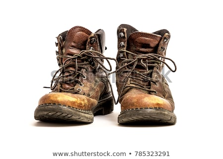 Old worn out leather dirty work boots Stock photo © byjenjen