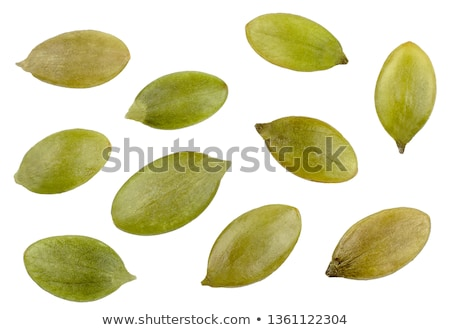 Pumpkin seeds isolated on the white background Stock photo © ozaiachin