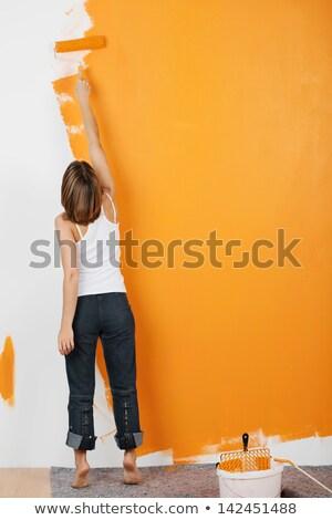 woman with orange paint Stock photo © dolgachov