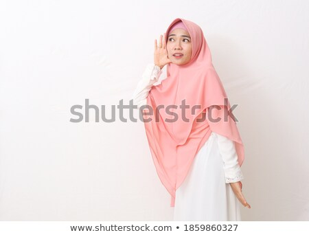 Young happy woman listening carefully with copy space Stock photo © rosipro