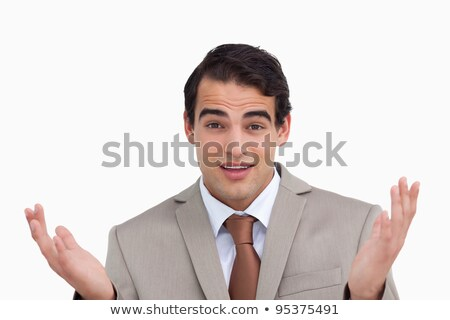 Close up of clueless businessman against a white background Stock photo © wavebreak_media