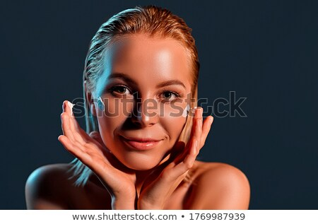 Perfect woman face with dark background Stock photo © konradbak