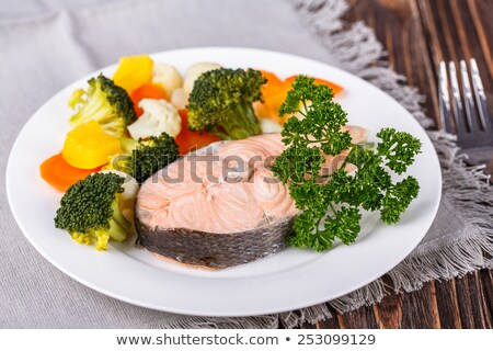 Cooked salmon steak with rosemary in a steamer Stock photo © Len44ik