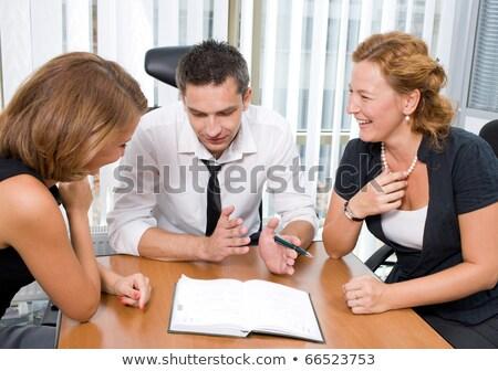 businessman explaining to his colleague with big smile stock photo © wavebreak_media