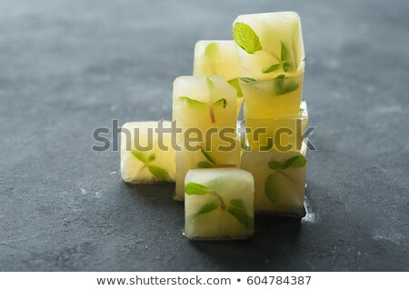 cocktail with ice cube and lemon slice Stock photo © M-studio