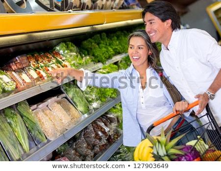 Boldog pár élelmiszer vásárlás helyi áruház Stock fotó © HASLOO