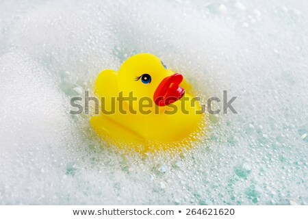 Yellow duck in bathtub with bubbles Stock photo © adrian_n