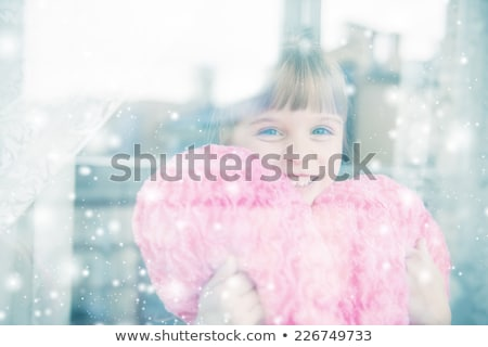 young happy girl behind snow window Stock photo © utorro