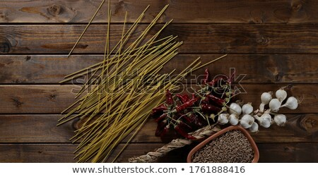 Food spelt with chili peppers Stock photo © leungchopan