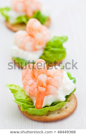 Party snacks. Prawns on a bed of lettuce and cottage cheese Stock photo © raphotos