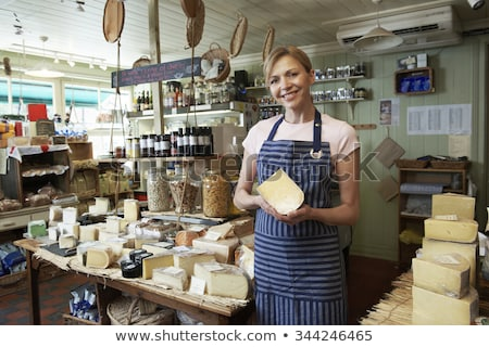 kobieta · stałego · sklepu · uśmiechnięta · kobieta · uśmiechnięty - zdjęcia stock © highwaystarz