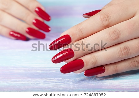 Female hands with long fingernails Stock photo © Nobilior
