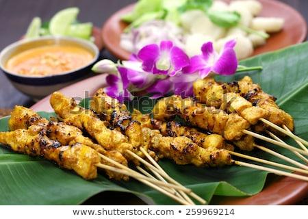 finom · ázsiai · konyha · tyúk · étel · tányér · hús - stock fotó © dinozzaver