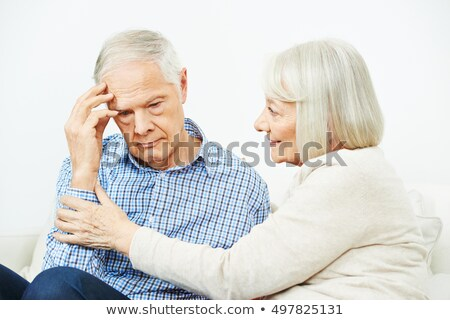 Woman Comforting Senior Man With Depression Stock photo © HighwayStarz