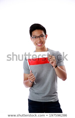 smiling asian man holding flag of poland over white background stock photo © deandrobot