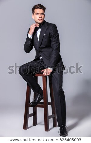 side view picture of a young elegant business man sitting stock photo © feedough