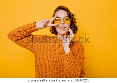 closeup portrait of a young cheerful woman in glasses stock photo © deandrobot