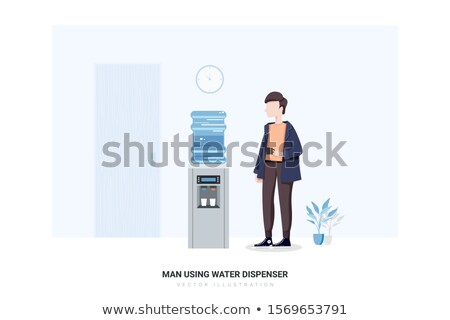 Young woman using water dispenser at office Stock photo © HASLOO