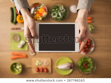 Tablet on kitchen table stock photo © manera
