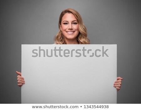 Vonzó szőke nő tart fehér tábla szexi karcsú Stock fotó © NeonShot