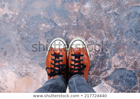 Feet From Above, Teenager in Sneakers Standing on Brown Backgrou Stock photo © stevanovicigor