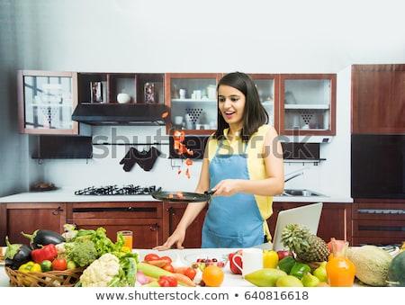 Housewife girl cooking food Stock photo © Aleksangel