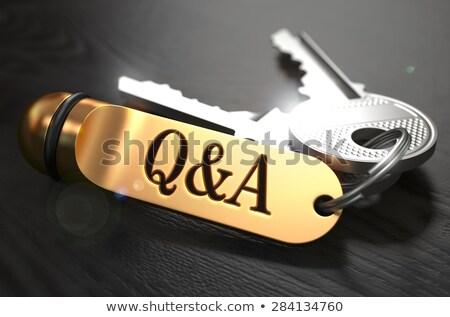 Kérdések válaszok kulcsok arany fekete fa asztal Stock fotó © tashatuvango