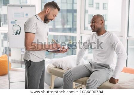 человека · терапевт · сидят · диване · черный - Сток-фото © wavebreak_media
