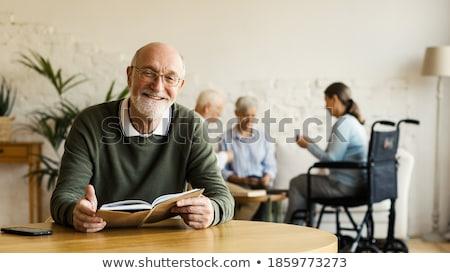 счастливым группа мужчин смеясь камеры сидят Сток-фото © feedough