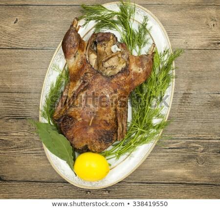 Feestelijk eend houten tafel appel vlees citroen Stockfoto © mcherevan