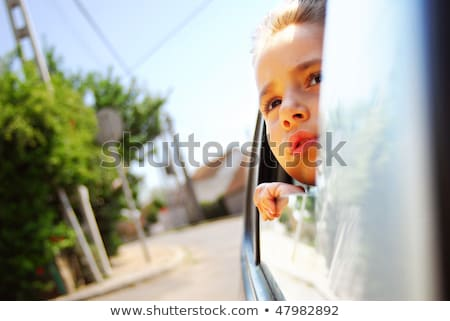 Girl in the car looking throw window Stock photo © Paha_L