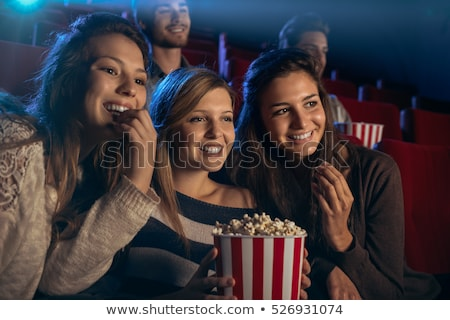 Stockfoto: Meisje · bioscoop · muziek · Blauw · stoel · star