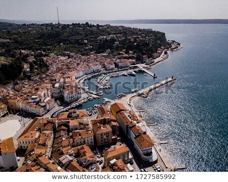 Buildings of Piran Old Town Reflected in Water. Stock photo © Kayco