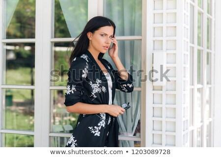 Káprázatos üzletasszony sétál múlt fal fiatal Stock fotó © dash