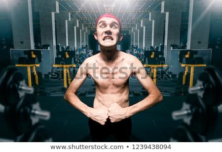 funny image of a skinny bodybuilder stock photo © konradbak
