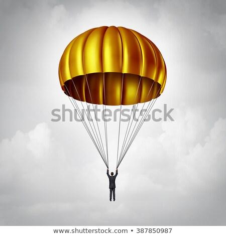 парашютом бизнесмен вниз золото Сток-фото © Lightsource