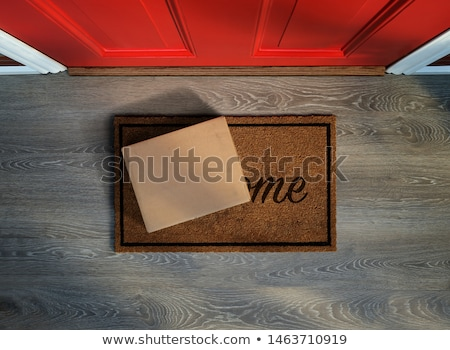 Delivery postman with a box. Stock photo © Kurhan
