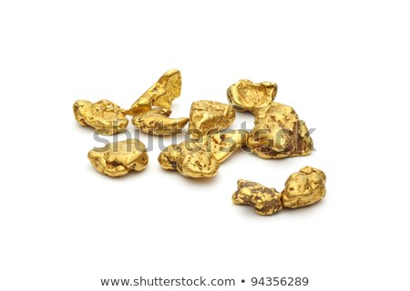 handful of gold nuggets close-up Stock photo © OleksandrO