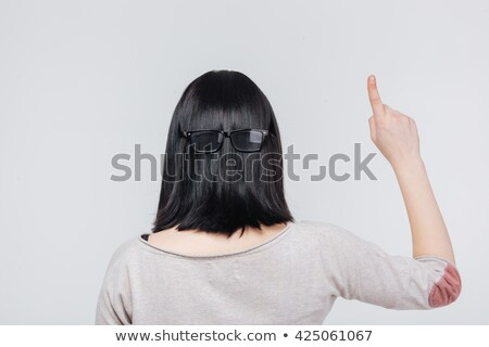 Back view portrait of a brunete girl pointing finger up  Stock photo © deandrobot