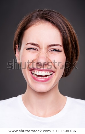 emotional portrait of happy and laughing woman over dark background Stock photo © traza