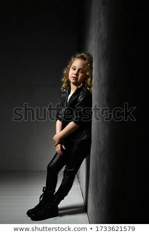 Stok fotoğraf: Fashionable Blonde Posing At Twillight