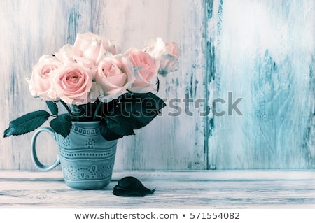 blue flowers in a blue vase stock photo © bluering