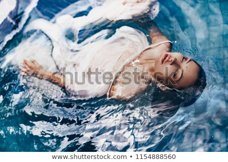 Conceptual image of a young fashionable beauty Stock photo © konradbak
