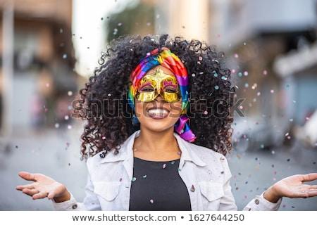 Kadın kostüm gülümseyen kadın mavi tüyler karnaval Stok fotoğraf © robuart