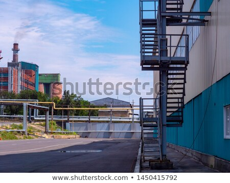 Industrial silos with external staircase Stock photo © Klinker