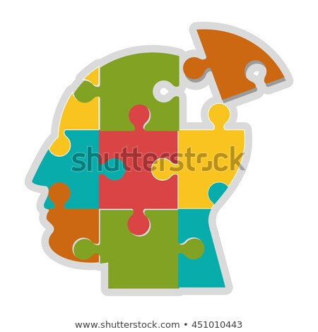 Icon of a head cut into jigsaw puzzle pieces Stock photo © adrian_n