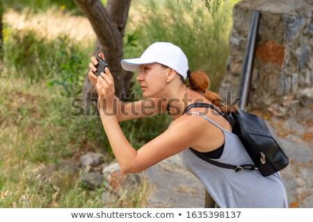 mulher · jovem · telefone · ensolarado · rua · retrato · bonitinho - foto stock © lightpoet